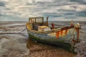 Old fishing boat on Meols beach